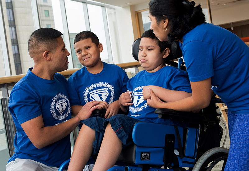 The Rojas family, who have two sons with ALD,at a recent visit to Boston Children's.