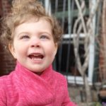 Ellery, who has OMS, plays outside