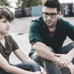 father and son discussing behavioral health