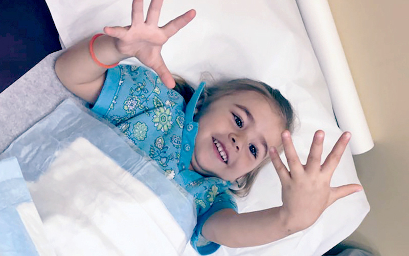 A young female patient admires her hands and fingers.